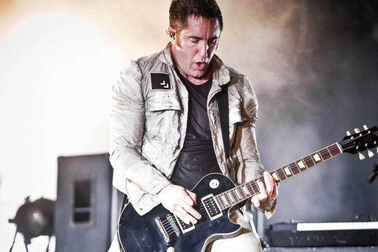 FILE - In this June 27, 2009 file photo, U.S. singer of the band Nine Inch Nails, Trent Reznor, performs during the Music Openair Festival in St. Gallen, Switzerland. (AP Photo/Keystone, Ennio Leanza, file) NYTCREDIT: Ennio Leanza/Keystone, Via Associated Press 16golden