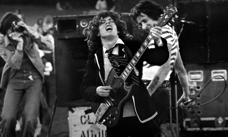 Mandatory Credit: Photo by Philip Morris / Rex Features ( 605955h ) AC/DC in concert, Angus Young and Bon Scott - 1975 Various - 1970s